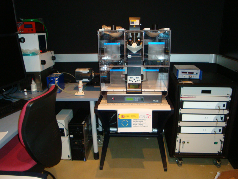 Leica microscope with side camera, special vibration table, incubator chamber and laser rack